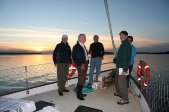 Guests watching the sun set aboard a Bluewater Adventure's yacht